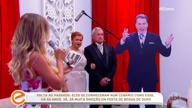 Casal encontrando Silvio Santos de papelão no programa de Eliana.